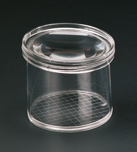 Bottle magnifier with grid
